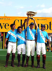 The winning team Azzura with the Gold Cup at the Veuve Clicquot sponsored Gold Cup or the British Open Polo Championship won by The  Azzura polo team who beat The Dubai polo team 17-9 at Cowdray Park, West Sussex on 18th July 2004.