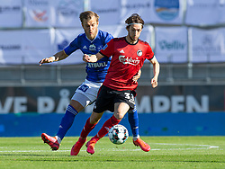 Rasmus Falk (FC København) og Frederik Gytkjær (Lyngby Boldklub) under kampen i 3F Superligaen mellem Lyngby Boldklub og FC København den 1. juni 2020 på Lyngby Stadion (Foto: Claus Birch).