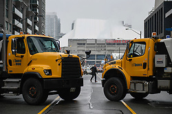 City of Toronto trucks block off Bremner Boulevard east of Lower Simcoe Street outside the Air Canada Centre in Toronto, ON, Canada, Wednesday, April 25, 2018. Fans attending the tailgate party in Maple Leaf Square will be met with increased security, including road closures around the arena. Photo by Galit Rodan/CP/ABACAPRESS.COM