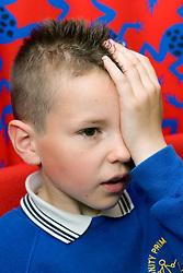 Young boy taking eyesight test,