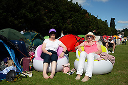 Marian Roberts (left) and Gina Lee who have travelled from North Wales  pictured during day one of the Wimbledon Championships at the All England Lawn Tennis and Croquet Club, Wimbledon. The friends have been camping near the site in the hope of getting tickets to see Roger Federer play. Photo credit should read: Katie Collins/EMPICS