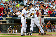 Minnesota Twins catcher Joe Mauer #7 is congratulated by teammate Josh Willingham #16 after hitting a home run against the Baltimore Orioles at Target Field in Minneapolis, Minnesota on July 16, 2012.  The Twins defeated the Orioles 19 to 7 setting a Target Field record for runs scored by the Twins.  © 2012 Ben Krause