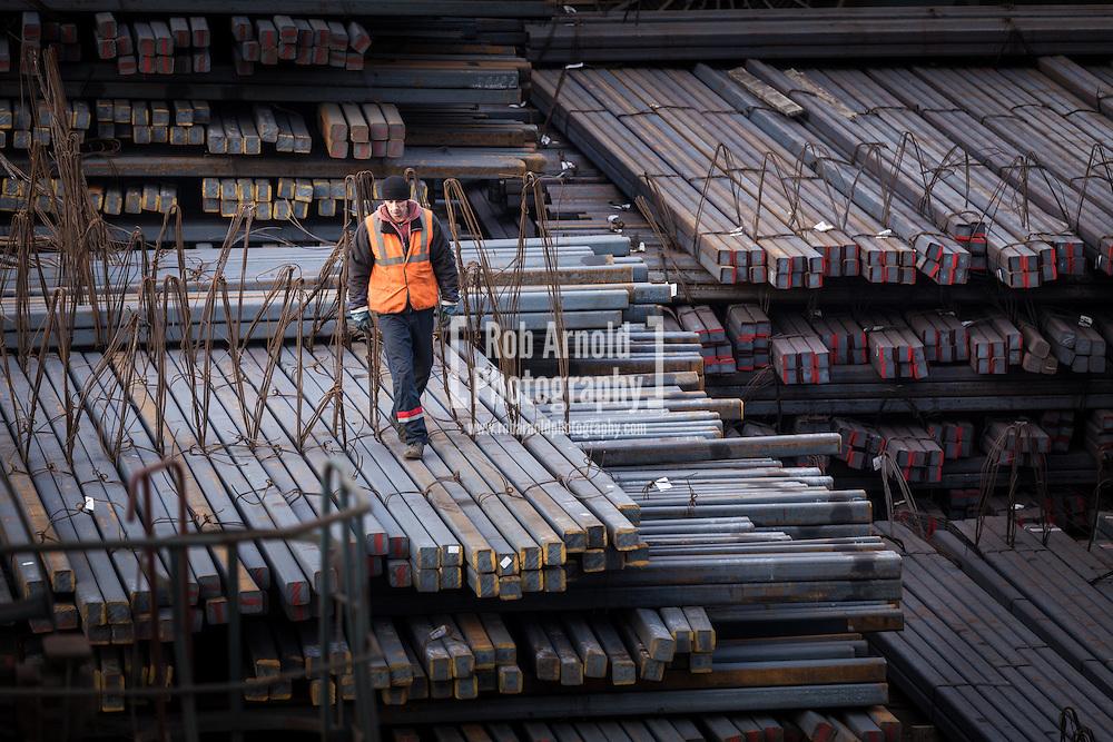 A man preparing steel 'sticks' for export in the Russian Black Sea port of Novorossiysk