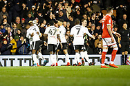 Fulham players celebrate a goal from Fulham forward Sheyi Ojo (19) (score 2-1) during the EFL Sky Bet Championship match between Fulham and Barnsley at Craven Cottage, London, England on 23 December 2017. Photo by Andy Walter.