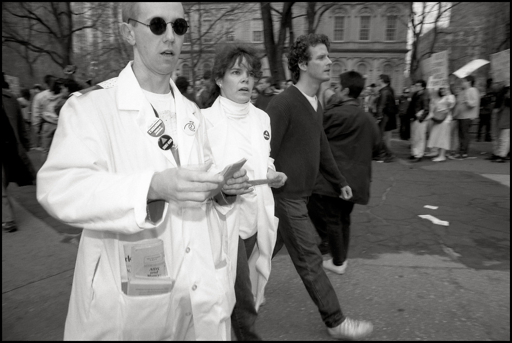 Mark Harrington and Pam Earing, on March 28th, 1989, as ACT UP descended on New York City Hall to protest the inadequacy of New York City's AIDS policies under Mayor Ed Koch. While the city saw one fourth of the nation's total deaths, Mayor Koch neglected the AIDS crisis and cut local and state AIDS services.