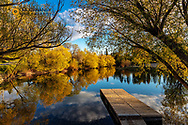 Dock in spring on the Whitefish River in Whitefish, Montana, USA