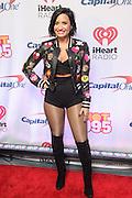 DEMI LOVATO walks the red carpet at the Hot 99.5 Jingle Ball at the Verizon Center in Washington, D.C.