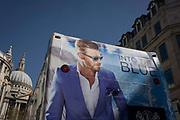 An advert for Italian fashion brand Boggi Milano on the back of a London tour bus with the dome of St. Paul's Cathedral in the distance. Boggi Milano is a clothing brand founded in 1939 which is known for its production of quality shirts.