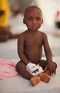 Mylove Fenelis recovering from cholera at the  cholera treatment center in the Tabarre section of Port-au-Prince run by Doctors without Boarders (MSF) that  treats hundreds of cholera patients a day.