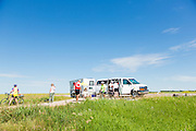 Cyclists at rest stop on Highway 14, near Palo, east of Landis.