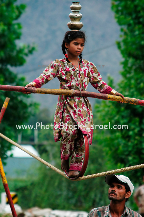 India, Kullu District, Himachal Pradesh, Northern India A travelling circus, a young girl on a tight rope
