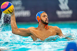 Bilal Gbadamassi of the Netherlands in action against Montenegro during the Olympic qualifying tournament. The Dutch water polo players are on the hunt for a starting ticket for the Olympic Games on February 19, 2021 in Rotterdam