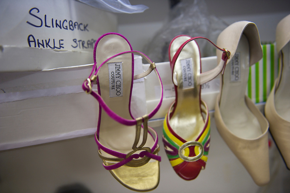 Pairs of bespoke Jimmy Choo shoes hang on display in his studio on Cannaught Street, London, March 22, 2010.