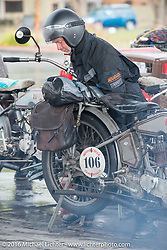 Paul Jung of Germany at a rainy gas stop with the 1915 Harley-Davidson entry from W and W Cycles of Wurzburg during the Motorcycle Cannonball Race of the Century. Stage-11 ride from Durango, CO to Page, AZ. USA. Wednesday September 21, 2016. Photography ©2016 Michael Lichter.