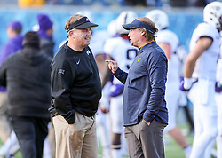 Nov 10, 2018; Morgantown, WV, USA; TCU Horned Frogs head coach Gary Patterson and West Virginia Mountaineers head coach Dana Holgorsen talk before the game at Mountaineer Field at Milan Puskar Stadium. Mandatory Credit: Ben Queen-USA TODAY Sports