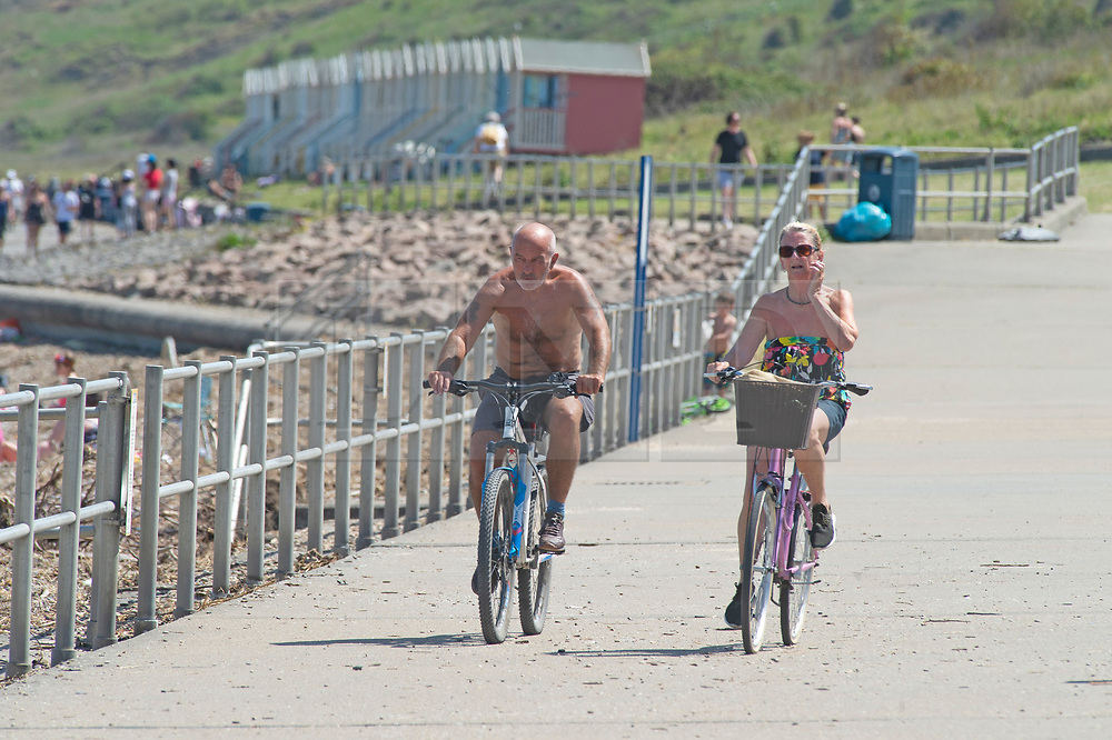 ©Licensed to London News Pictures 20/05/2020  <br /> Minster on sea, UK. Cyclists. People enjoying their lockdown freedom with a day by the sea at Minster-on-sea on the Isle of Sheppey in Kent. Today is expected to be the hottest day of the year with temperatures in the South East of the UK to hit around 29C. Photo credit:Grant Falvey/LNP