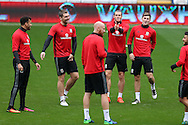 Gareth Bale of Wales © has fun with James Collins (front) , Ben Davies ® and Sam Vokes (2nd left)  during the Wales football team training at the Cardiff city Stadium in Cardiff , South Wales on Saturday 8th October 2016, the team are preparing for their FIFA World Cup qualifier home to Georgia tomorrow. pic by Andrew Orchard, Andrew Orchard sports photography