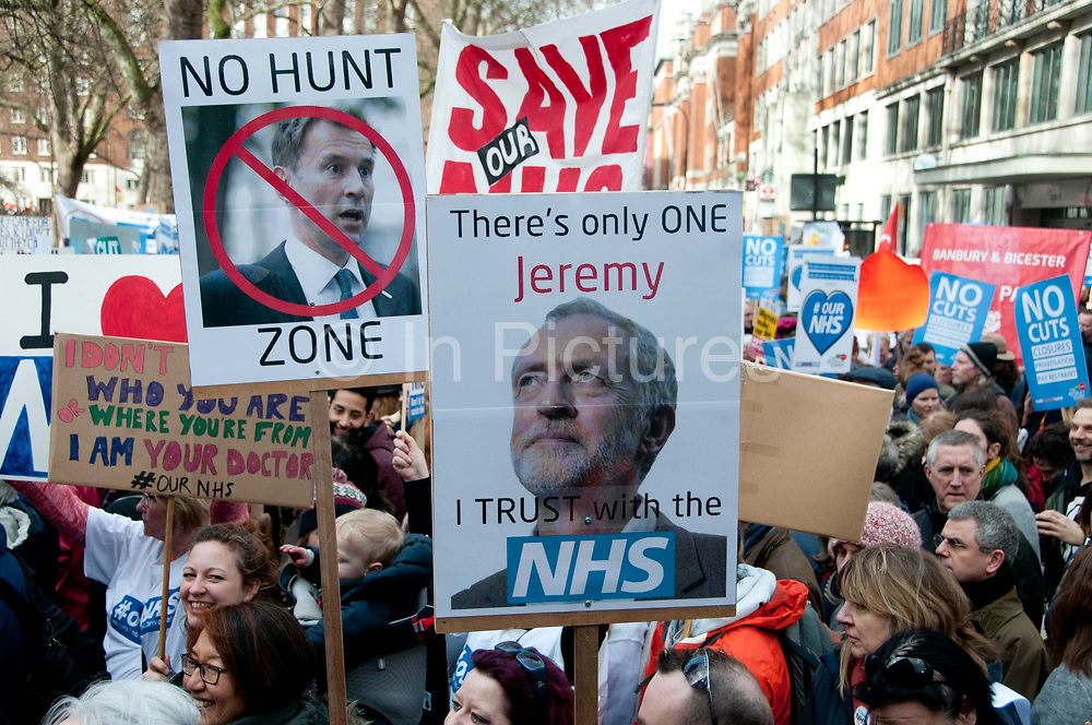 Tens of thousands of health workers, activists and members of the public protested against austerity and cuts in the NHS National Health Service on March 4th 2017 in London, United Kingdom. One protester holds a photo of Jeremy Hunt, health minister with a no entry sign and the words No Hunt Zone, whilst another hold one with a photo of Jeremy Corbyn and the words there is only one Jeremy I trust with the NHS.