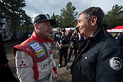 June 30, 2013 - Pikes Peak, Colorado.  Greg Tracy talks withfriends after the 91st running of the Pikes Peak Hill Climb.