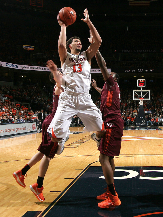 Virginia forward Anthony Gill (13) shoots the ball during the game Saturday in Charlottesville, VA. Virginia won 65-45.