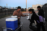An unprecedented joint effort between Dorothy's Place staff, CSUMB's Service Learning Institute and a number of dedicated volunteers helped allay resident's anxiety prior to a City of Salinas sweep of the Chinatown homeless encampments in the Soledad Street area. Packing materials were gathered weeks in advance of the regular cleanup, and at first light teams of volunteers woke people up, offering coffee, breakfast, and moving supplies such as boxes and large plastic containers to the needy. In an innovative move, CSUMB's fenced area next to the Chinatown Community Learning Center was designated a secure belongings zone for the day, manned by a check-in system, enabling residents to reclaim their possessions at the end of the day. Food and music was planned for later in the day inside the Chinatown Community Gardens. This well-organized plan made a noticeable difference to everyone. Residents were more prepared for the event, and that made the city's effort to ensure cleanliness in the area less traumatic.