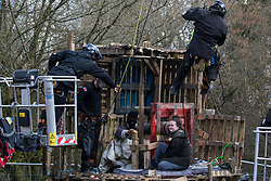 Denham, UK. 22nd March, 2021. Bailiffs from the National Eviction Team (NET) work to remove activists opposed to the HS2 high-speed rail link from a makeshift tower in Denham Country Park where they had been seeking to delay electricity pylon relocation works by Babcock in connection with the project.