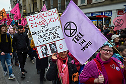 """© Licensed to London News Pictures. 22/02/2020. LONDON, UK.  Activists from Extinction Rebellion take part in march called """"Enough is enough, Together we march"""" from Russell Square to Parliament Square calling for governments to act on the negative effects of climate change.  Photo credit: Stephen Chung/LNP"""