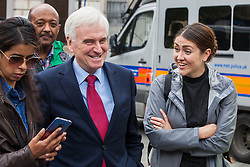 London, UK. 19 June, 2019. Shadow Chancellor John McDonnell joins outsourced catering, security, postal, porter and cleaning staff belonging to the Public & Commercial Services Union (PCS) and working at the Department for Business, Energy and Industrial Strategy (BEIS) via contractors ISS World and Aramark at a rally outside Parliament on the third day of continuing industrial action for the London Living Wage, terms and conditions comparable to the civil servants they work alongside and an end to outsourcing.