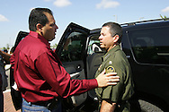 Photo by Alex Jones..Hidalgo County Judge J.D. Salinas addresses US Border Patrol Chief David Aguilar as Aguilar leaves a meeting of the Texas Border Coalition on June 1.  Salinas has been a vocal critic of plans to build a border fence to help control illegal immigration.