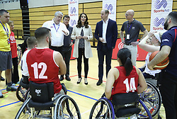 The Duke and Duchess of Cambridge meet wheelchair basketball players during a SportsAid event at the Copper Box in the Olympic Park, London.