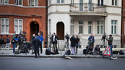 © Licensed to London News Pictures. 04/02/2016. London, UK. Journalists and TV crews wait across the road from the Ecuadorian Embassy where Wikileaks founder Julian Assange is living.  A United Nations panel is due to decide if Julian Assange has been kept in 'unlawful detention' during his stay at the embassy for the past three-and-a-half-years. Photo credit: Peter Macdiarmid/LNP