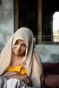 Chandrabhati, 50, is portrayed while sitting on a bed in her house, located in the village of Simlana, pop. 4000, Saharanpur District, Uttar Pradesh, India, on Saturday, Mar. 29, 2008. Due to the contaminated water she has been drinking, originating from a hand-pump at the shallow depth of 70 ft, she was diagnosed a severe case of eye disease that made her totally blind seven years ago. She visited two different hospital in Saharanpur to no avail. The family has since time stopped drinking from the pump delivering yellow-coloured water and has been able to install a safer one, at the depth of 100 ft. As pollution grows unabated, and penetrates the soil deeper and deeper, there is a risk that even the newest pumps, some as deep as 200 ft, will soon be showing signs of contamination.
