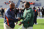 Oct 30, 2010; Charlottesville, VA, USA;   Miami Hurricanes head coach Randy Shannon, right,  and Virginia Cavaliers head coach Mike London shake hands before the game at Scott Stadium.  Mandatory Credit: Andrew Shurtleff