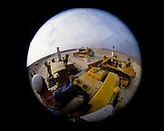 Oil industry in Ras Tanura area, Saudi Arabia,  caterpillar bulldozer vehicles fisheye photograph 1979