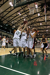 10 January 2009: Three Titans, Kylie Castans, Christina Solari, and Stacey Arlis all struggle for the same offensive rebound. The Lady Titans of Illinois Wesleyan University downed the and Lady Thunder of Wheaton College by a score of 101 - 57 in the Shirk Center on the Illinois Wesleyan Campus in Bloomington Illinois.