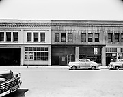 """Ackroyd 00072-30. """"Montgomery Ward Warehouse. May 17, 1947."""" exterior view shows the west side of NW 5th between Glisan & Hoyt."""