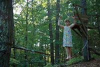 Jessica Laman (age 9) practices her slack lining (tight rope walking) in the back woods.<br /><br />Lexington, MA