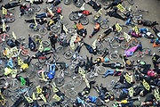 Cyclists from Extinction Rebellion  flying golden bee flags from their backpacks stage a die in demonstration at Tate Modern called XR Critical Swarm on 27th April 2019 in London, England, United Kingdom. The action aims to highlight the global decline in the bee population and the sudden eradication of bee colonies known as Colony Collapse disorder. The climate change activist group are targeting the Tate who they claim, built their fortune on sugar cane production from colonial exploitation of enslaved Africans, European invasion and exploitation of land in West Indies and South America.