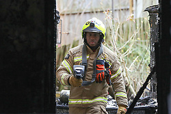 © Licensed to London News Pictures. 10/02/2020. London, UK. A fireman inside a property on Olinda Road, in Hackney, North London following a fire where a woman died. Police were called to Olinda Road at around midnight. According to the neighbours, the woman was in her 70s. Photo credit: Dinendra Haria/LNP