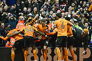 Wolves players celebrates their second goal with their supporters during the EFL Sky Bet Championship match between Nottingham Forest and Wolverhampton Wanderers at the City Ground, Nottingham, England on 17 December 2016. Photo by Jon Hobley.