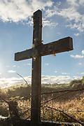 Close up of cross on graveyard near, Church of Vilupulli, Chiloe Island, Chile