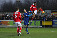 AFC Wimbledon Tyler Burey (38) battles for possession with Barnsley defender Ethan Pinnock (5) during the EFL Sky Bet League 1 match between AFC Wimbledon and Barnsley at the Cherry Red Records Stadium, Kingston, England on 19 January 2019.