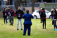 Hundreds of government workers gather in the grounds of 120 Racecourse Road for briefing amid a full and total lockdown of 9 housing commission high rise towers in North Melbourne and Flemington during COVID-19 on 5 July, 2020 in Melbourne, Australia. After 108 new cases where uncovered overnight, the Premier Daniel Andrews announced on July 4 that effective at midnight last night, two more suburbs have been added to the suburb by suburb lockdown being Flemington and North Melbourne. Further to that, nine high rise public housing buildings in these suburbs have been placed under hard lockdown for a minimum of five days, effective immediately.  Residents in these towers will not be allowed to leave their units for any reason. Police will be stationed at every entry and exit point, every level, and they will also surround these locations preventing any movement in, or out. There is a total of 1354 units and over 3000 residents living in these buildings including the states most vulnerable people. These new restrictions will remain in place for fourteen days with fears of further lockdowns to come. The Government have stressed that if Victorians do not follow the basic COVIDSafe rules, the whole state will go back in to lockdown. (Image by Dave Hewison/ Speed Media)