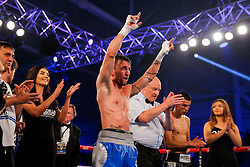 Lee Haskins (blue/white shorts) celebrates after he defeats Ivan Morales (black/white shorts) by unanimous decision to keep the IBF World Bantamweight Title - Mandatory byline: Rogan Thomson/JMP - 14/05/2016 - BOXING - Ice Arena Wales - Cardiff, Wales - Lee Haskins v Ivan Morales - IBF World Bantamweight Title.
