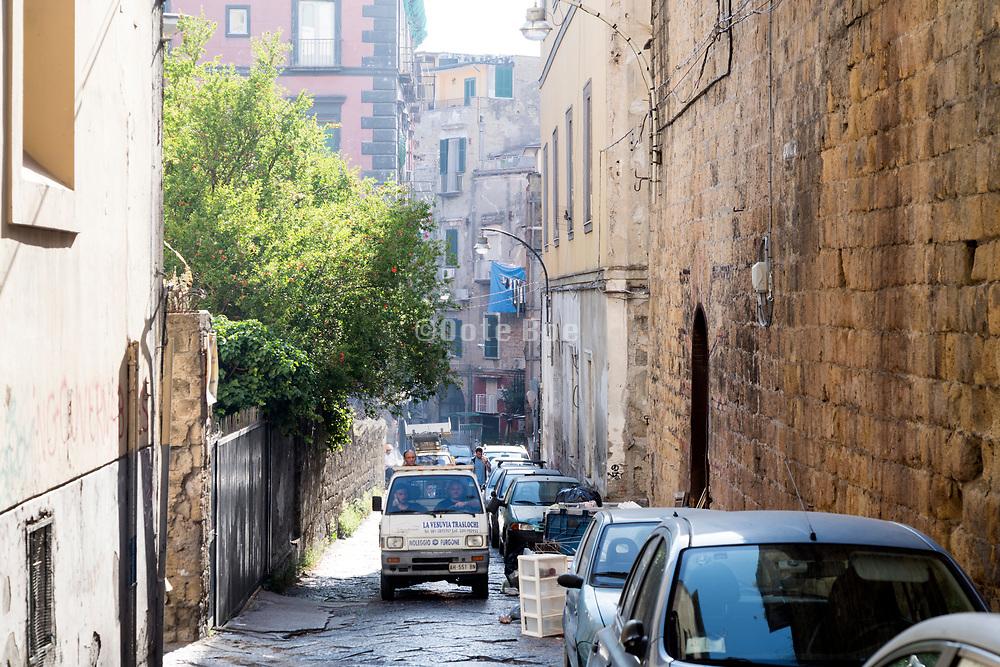narrow street scene in the Rione Sanità neighborhood of Naples Italy
