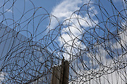 Razor wire on top of a security fence. HMP The Mount, Bovingdon, Hertfordshire