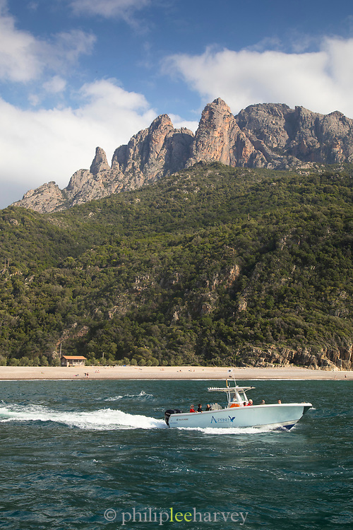 Motorboat on sea and coastline, Golf of Porto, Corsica, France