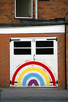 People  painting rainbows on their homes  in  spread cheer during coronavirus lockdown photo by Mark Anton Smith