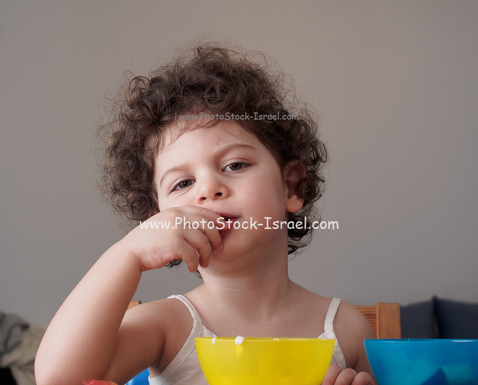 Day dreaming Toddler plays indoors