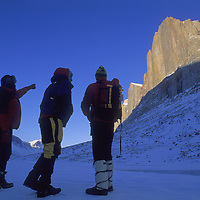 BAFFIN ISLAND, NUNAVUT, CANADA. Greg Child, Mark Synnott & Alex Lowe (MR) look for climbing route up Great Sail Peak from frozen lake in remote Stewart Valley, north of Clyde River.